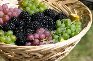 15355505-grapes-and-blackberries-in-a-wooden-basket-on-a-glass-table