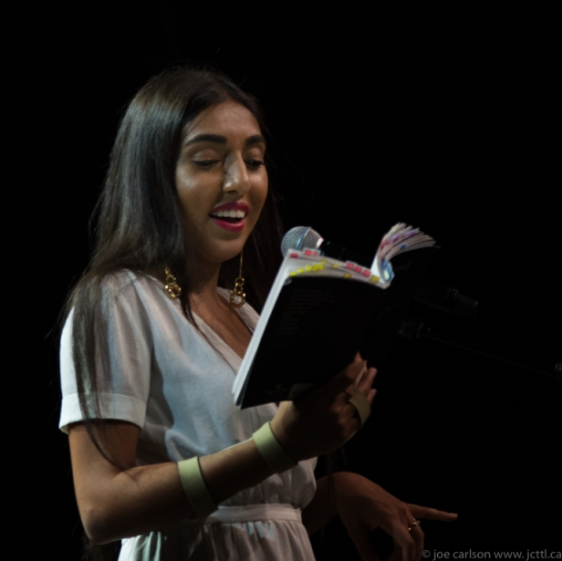 Rupi_Kaur_reading_from_her_book_milk_and_honey_in_Vancouver_-_2017